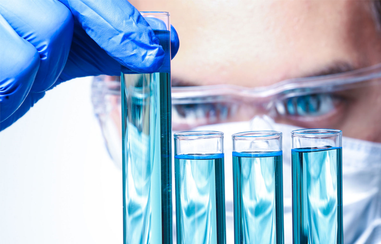 photo of a scientist looking at vials